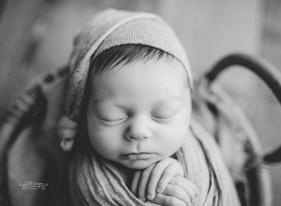 newborn boy with a sleeping cap