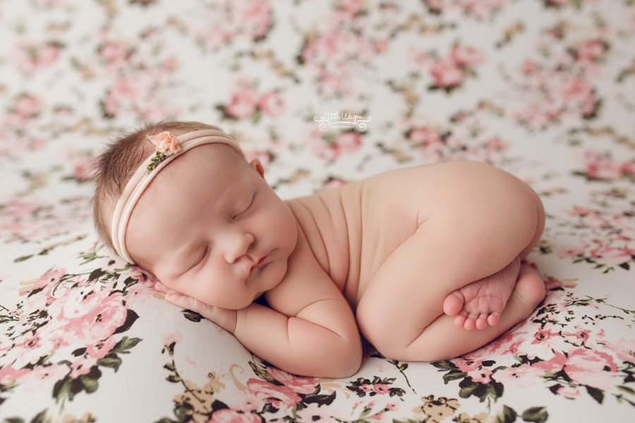 baby girl on flower backdrop, newborn photographers